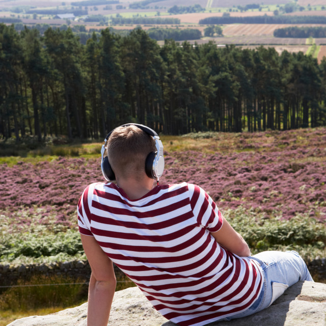 """""""Young Man Listening To Music In Countryside On Headphones"""" stock image"""