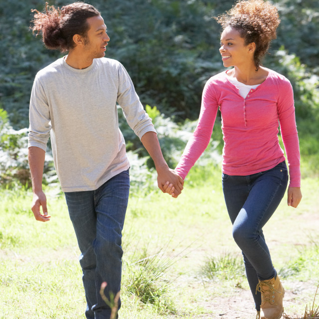 """""""Romantic Young Couple Walking In Countryside"""" stock image"""