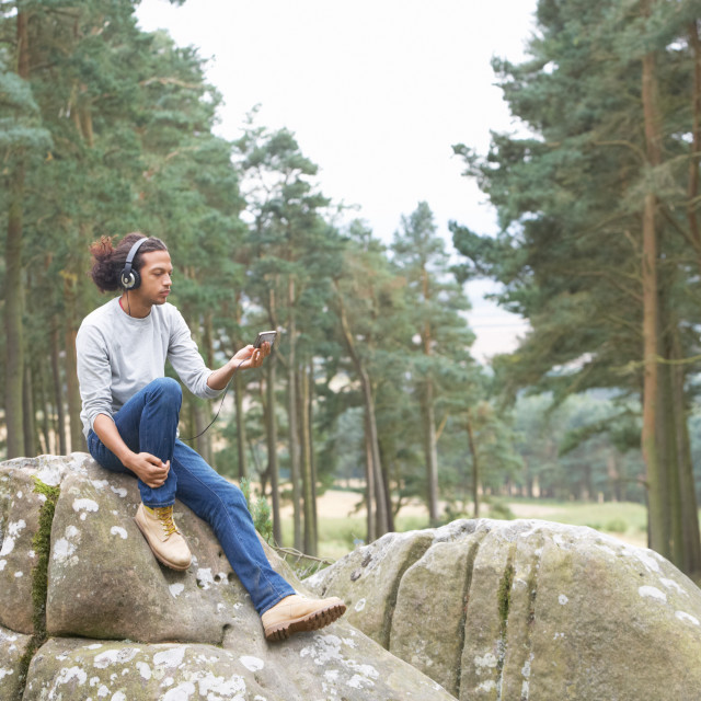 """""""Man Listening To MP3 Player Whilst Hiking"""" stock image"""