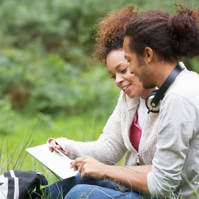 """""""Couple Using Digital Tablet Whilst Hiking In Countryside"""" stock image"""