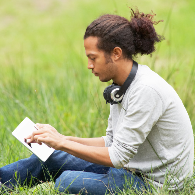 """""""Man Using Digital Tablet Whilst Hiking In Countryside"""" stock image"""