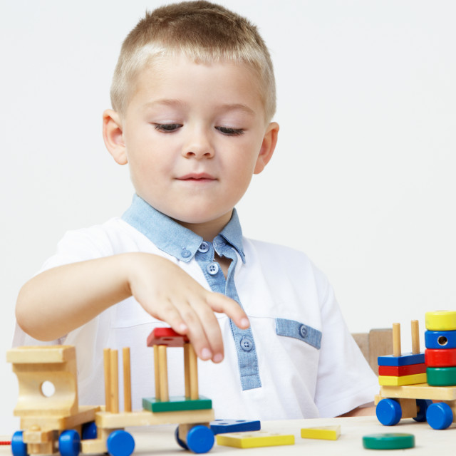 """""""Pre-School Pupil Playing With Wooden Toy Train"""" stock image"""