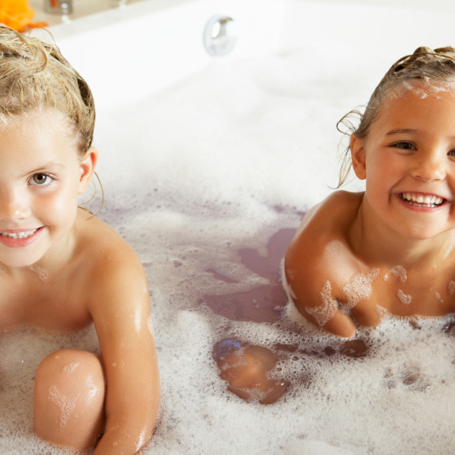 """""""Two Girls Playing In Bath Together"""" stock image"""