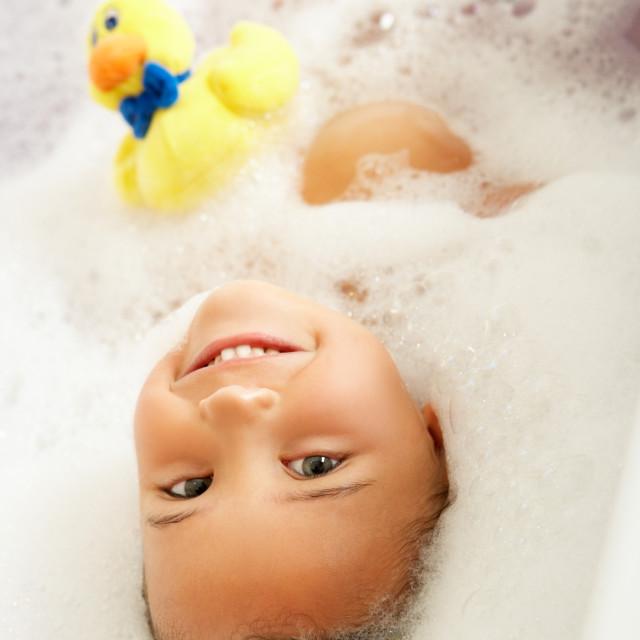 """Girl Playing In Bath"" stock image"