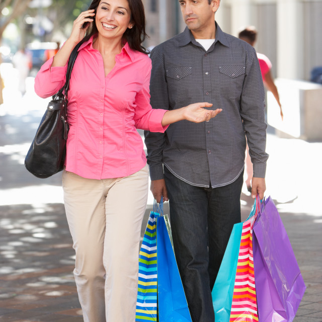 """""""Fed Up Man Carrying Partners Shopping Bags On City Street"""" stock image"""