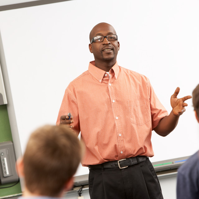 """""""Teacher Talking To Class Standing In Front Of Whiteboard"""" stock image"""