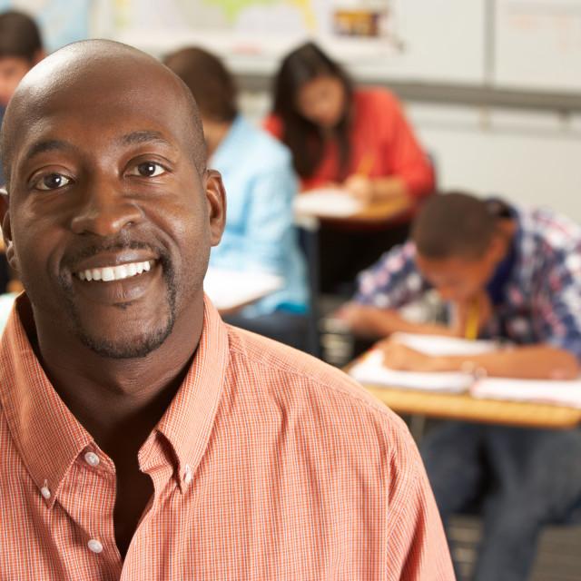 """Portrait Of Teacher In Classroom"" stock image"