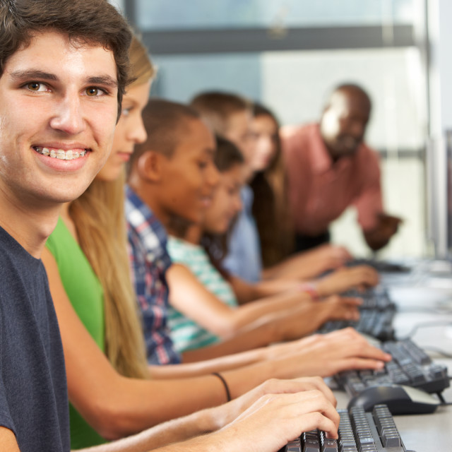"""""""Group Of Students Working At Computers In Classroom"""" stock image"""