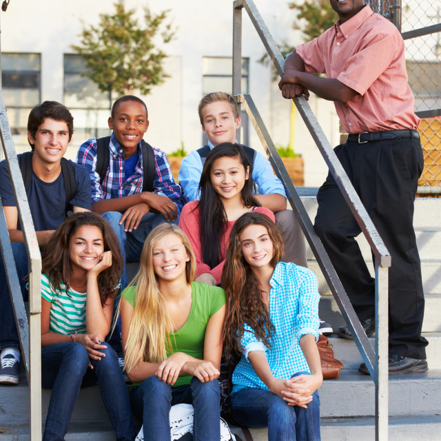 """""""Group Of Teenage Pupils Outside Classroom With Teacher"""" stock image"""