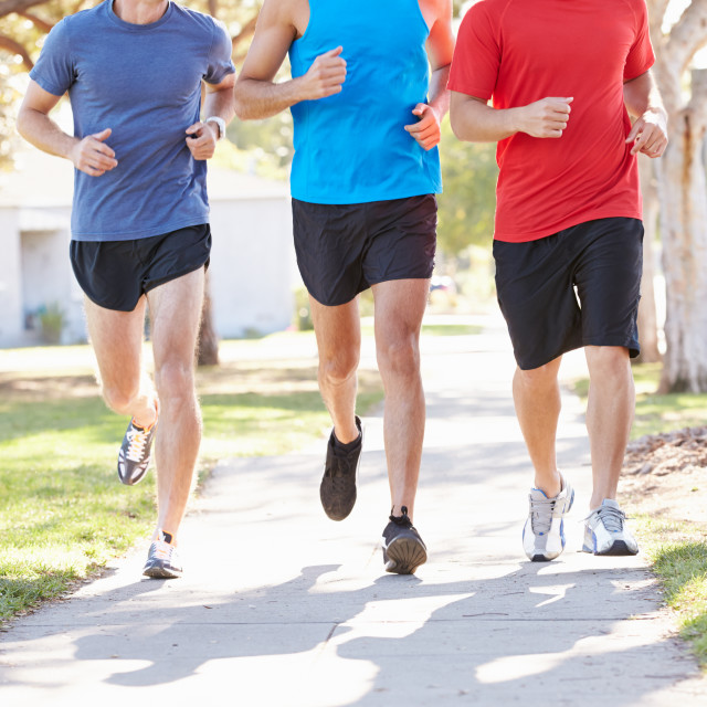 """""""Group Of Male Runners Exercising On Suburban Street"""" stock image"""