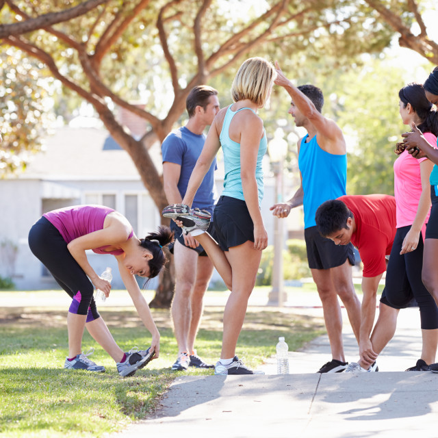 """""""Group Of Runners Warming Up Before Run"""" stock image"""