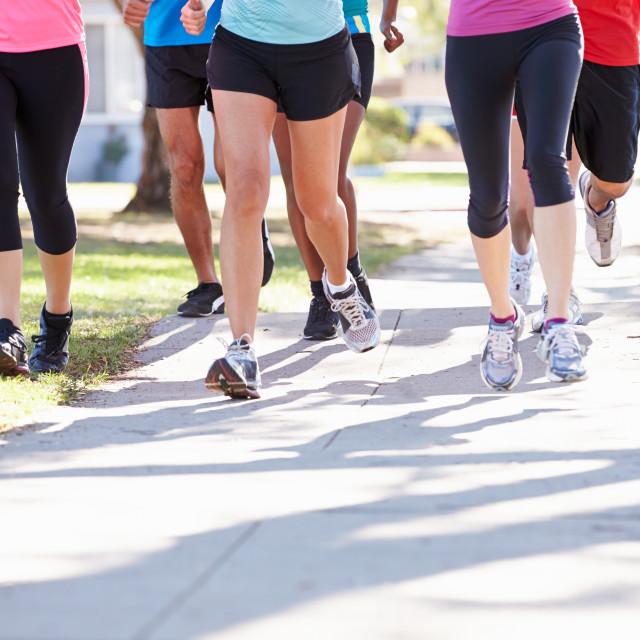 """Close Up Of Runners Feet On Suburban Street"" stock image"