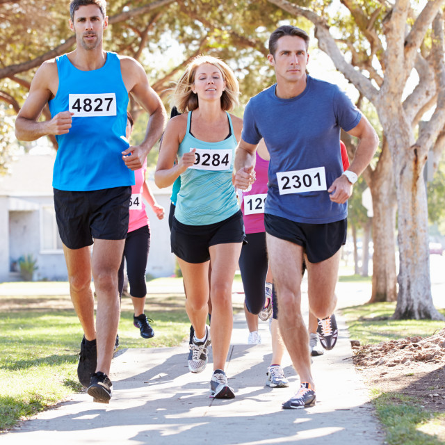 """""""Group Of Runners On Suburban Street"""" stock image"""