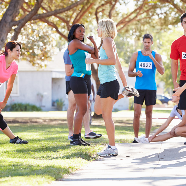 """""""Group Of Runners Warming Up Before Race"""" stock image"""
