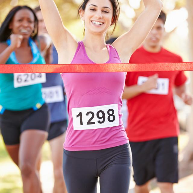 """Female Runner Winning Marathon"" stock image"