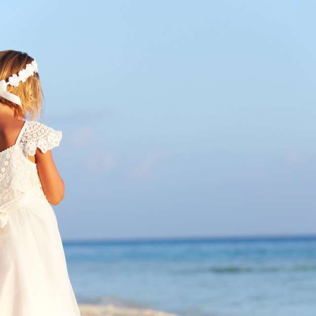 """Bridesmaid Standing On Beach At Wedding Ceremony"" stock image"