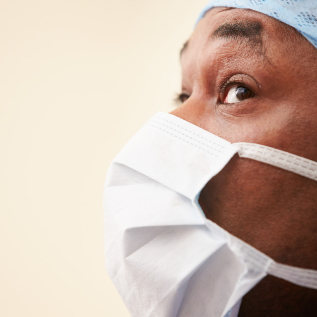 """Surgeon In Operating Theatre Wearing Scrubs And Mask"" stock image"