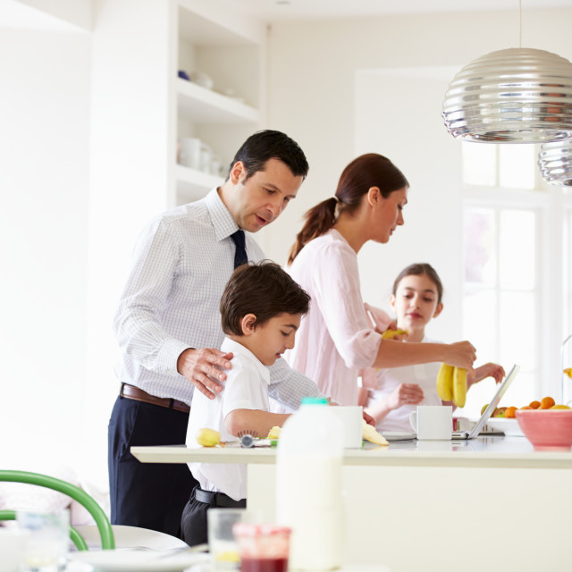 """Family Helping To Clear Up After Breakfast"" stock image"