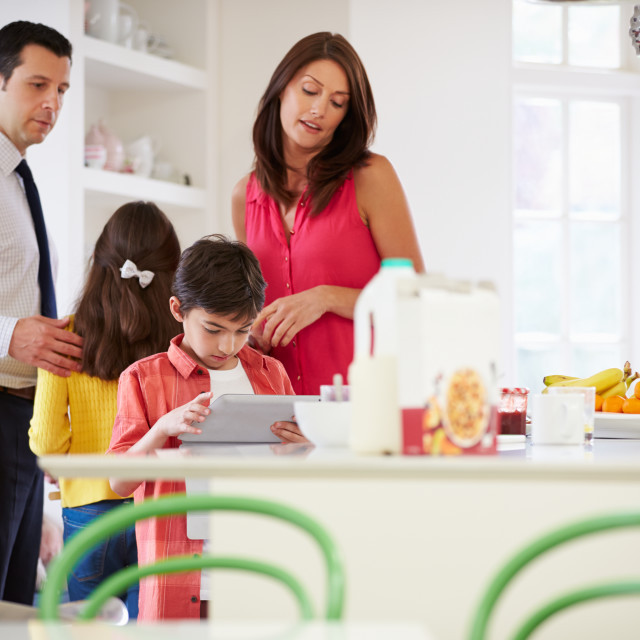 """""""Family Helping To Clear Up After Breakfast"""" stock image"""