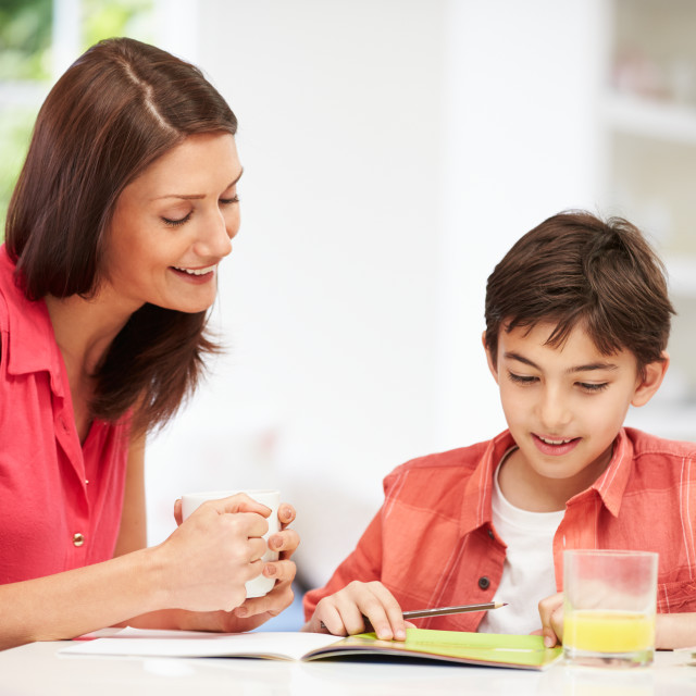 """Mother Helping Son With Homework"" stock image"