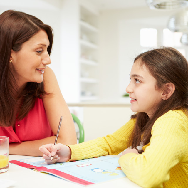 """Mother Helping Daughter With Homework"" stock image"