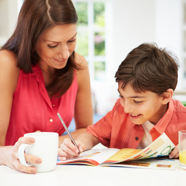 """""""Mother Helping Son With Homework"""" stock image"""