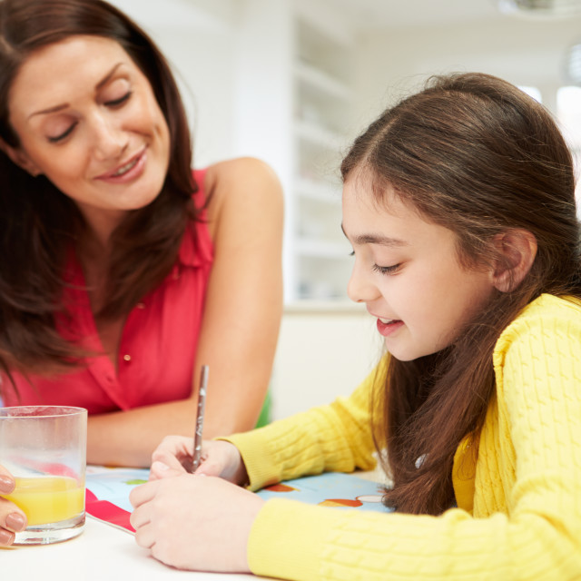"""""""Mother Helping Daughter With Homework"""" stock image"""