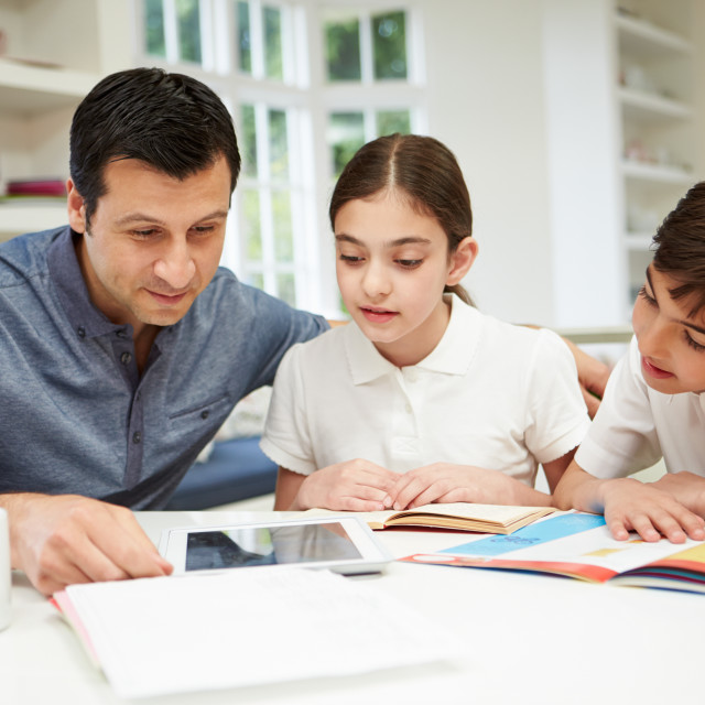 """""""Father Helping Children With Homework Using Digital Tablet"""" stock image"""