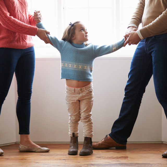 """Two Parents Fighting Over Child In Divorce Concept"" stock image"