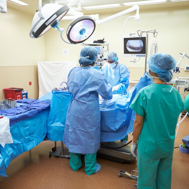 """""""Surgical Team Working In Operating Theatre"""" stock image"""