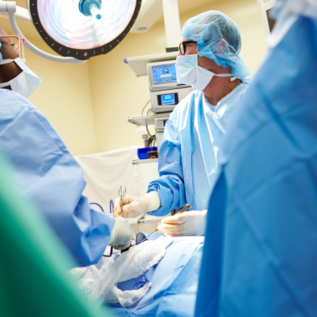 """Surgical Team Working In Operating Theatre"" stock image"
