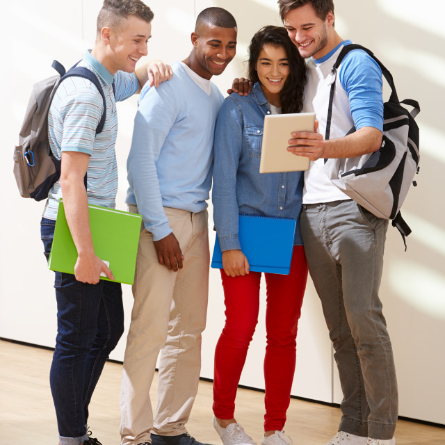 """Multi-Ethnic Group Of Students In Classroom With Digital Tablet"" stock image"