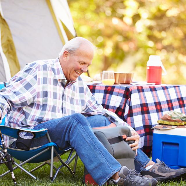 """Senior Man On Camping Holiday With Fishing Rod"" stock image"