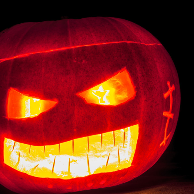 """Glowing scary Pumpkin head"" stock image"