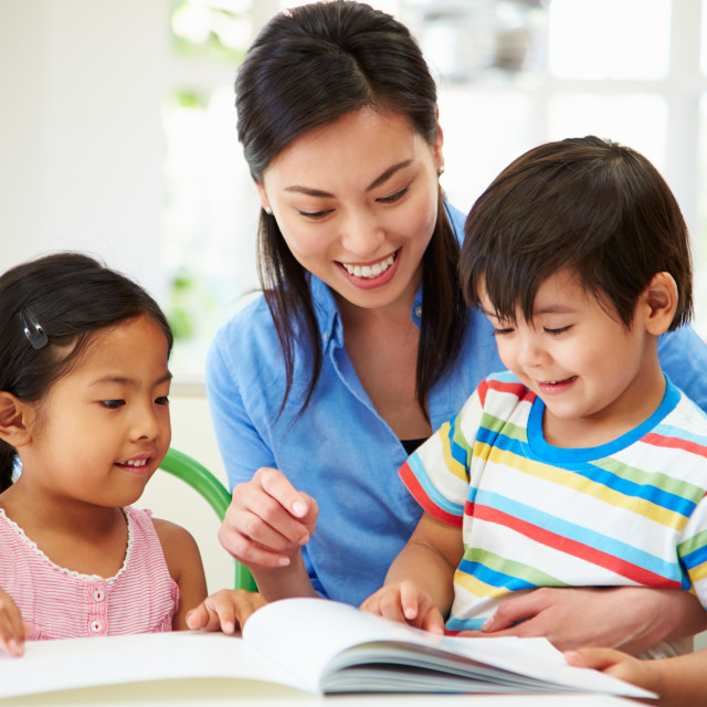"""Mother Helping Children With Homework"" stock image"