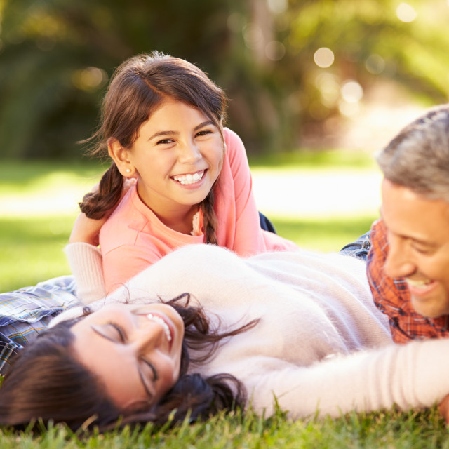 """""""Family Lying On Grass In Countryside"""" stock image"""