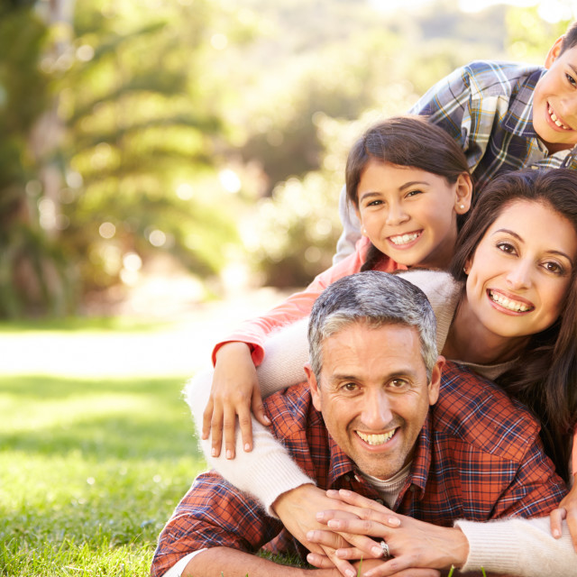 """""""Portrait Of Family Lying On Grass In Countryside"""" stock image"""