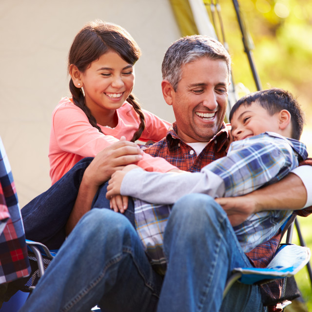 """""""Father With Children Enjoying Camping Holiday In Countryside"""" stock image"""