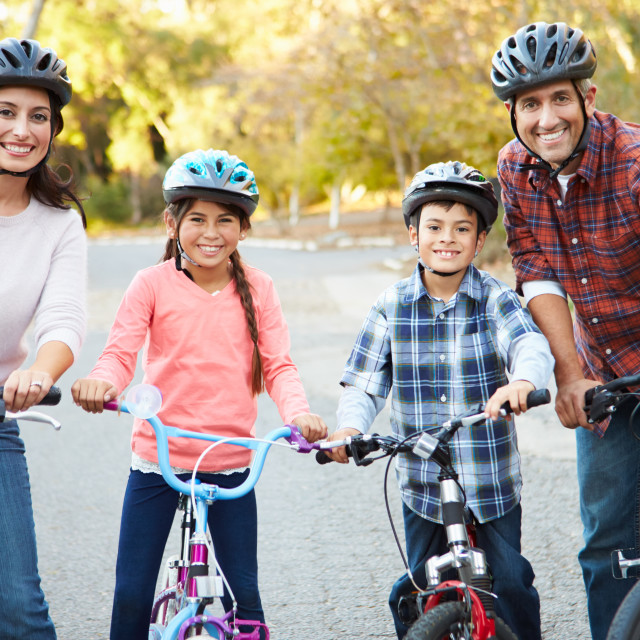 """""""Portrait Of Hispanic Family On Cycle Ride In Countryside"""" stock image"""