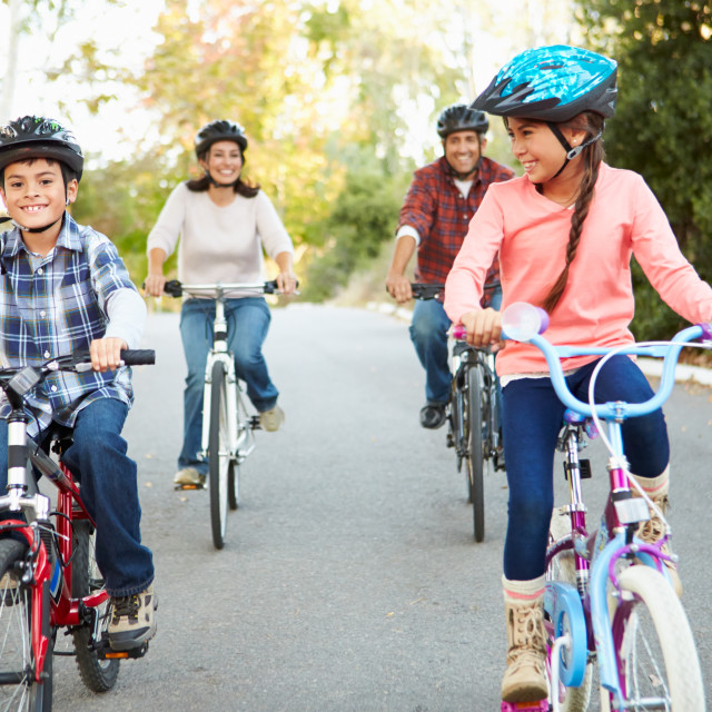 """""""Hispanic Family On Cycle Ride In Countryside"""" stock image"""