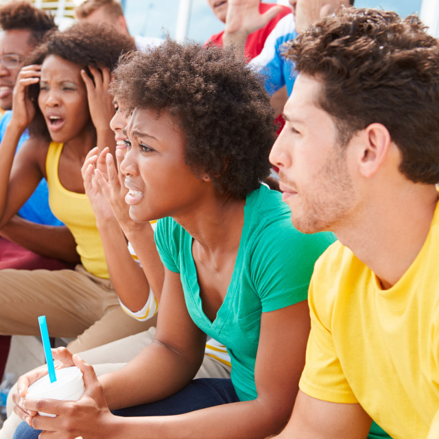 """""""Disappointed Spectators In Team Colors Watching Sports Event"""" stock image"""