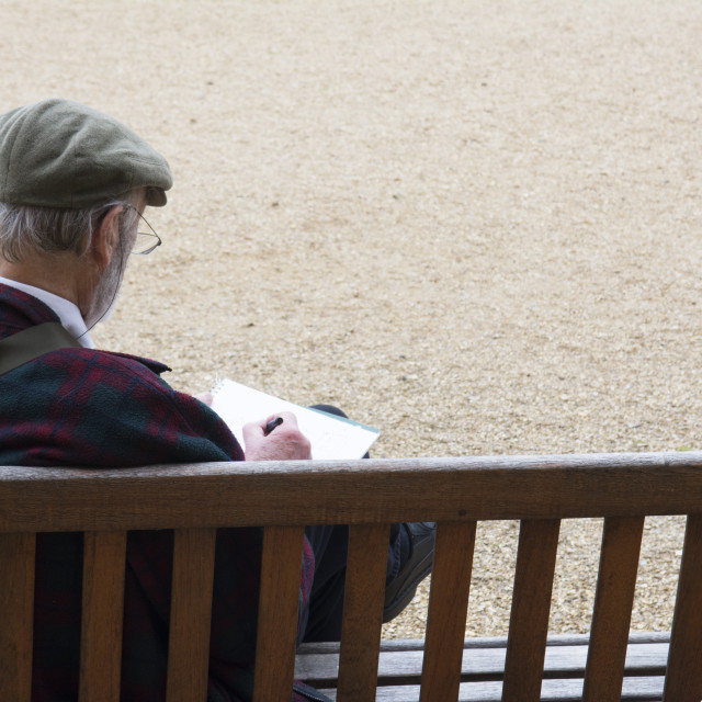"""""""Artist on a bench"""" stock image"""