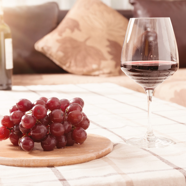 """""""Red Wine in Glass with Grapes on The Table"""" stock image"""