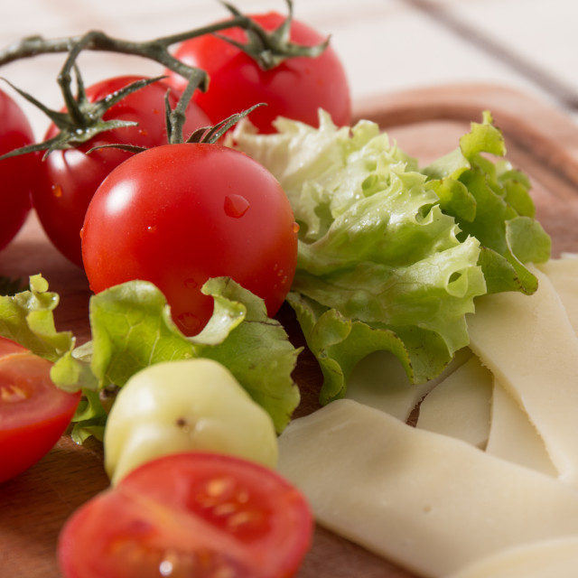"""Delicious Meat And Cheese Slices With Tomatoes"" stock image"