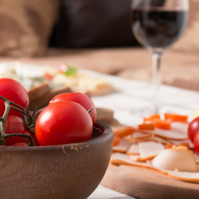 """Homemade dinner with bread, tomatoes, cheese, ham and wine"" stock image"