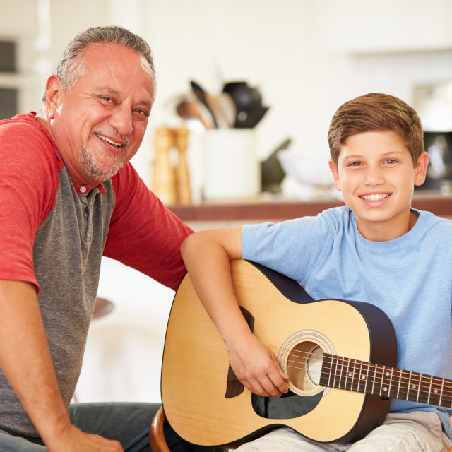 """""""Grandfather Teaching Grandson To Play Guitar"""" stock image"""