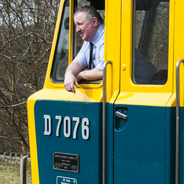 """Train driver looking out drivers window"" stock image"