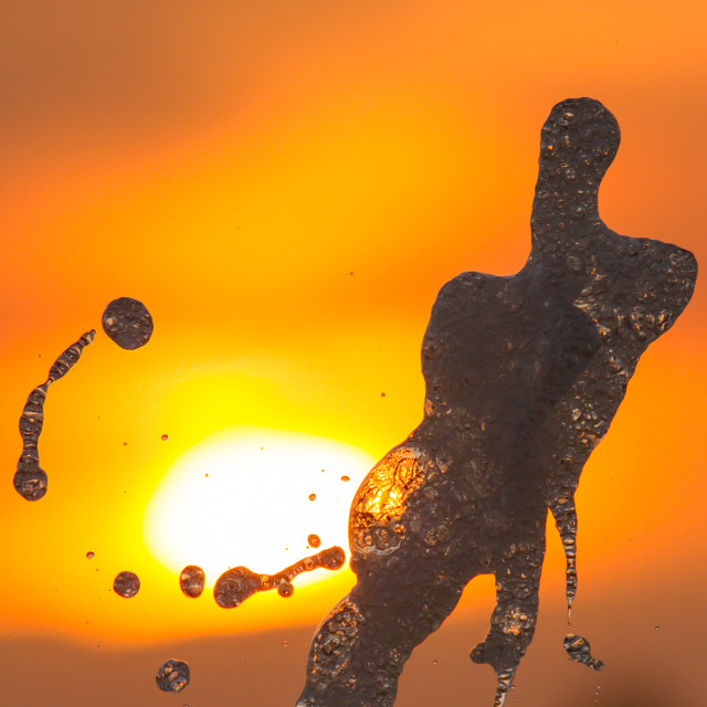 """""""A fountain in the sunset"""" stock image"""