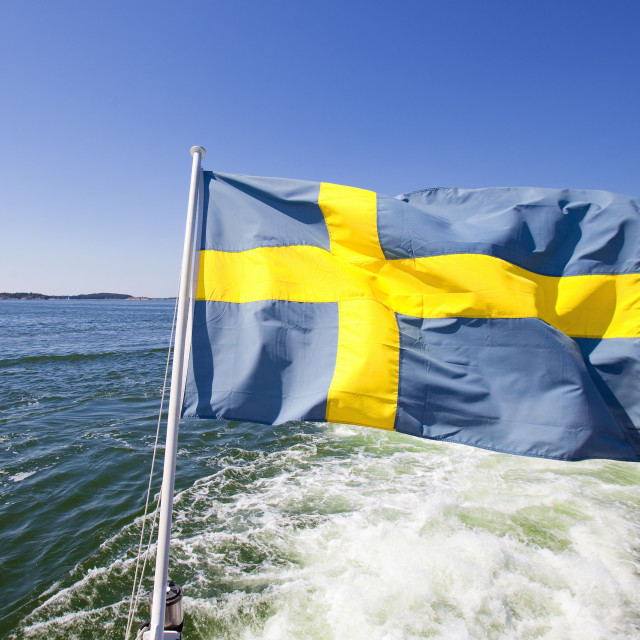 """Sweden, Stockholm Archipelago - Swedish Flag on a Ferry"" stock image"