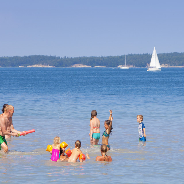 """""""Sweden, Stockholm - People having fun in water at Utö, outer archipelago"""" stock image"""